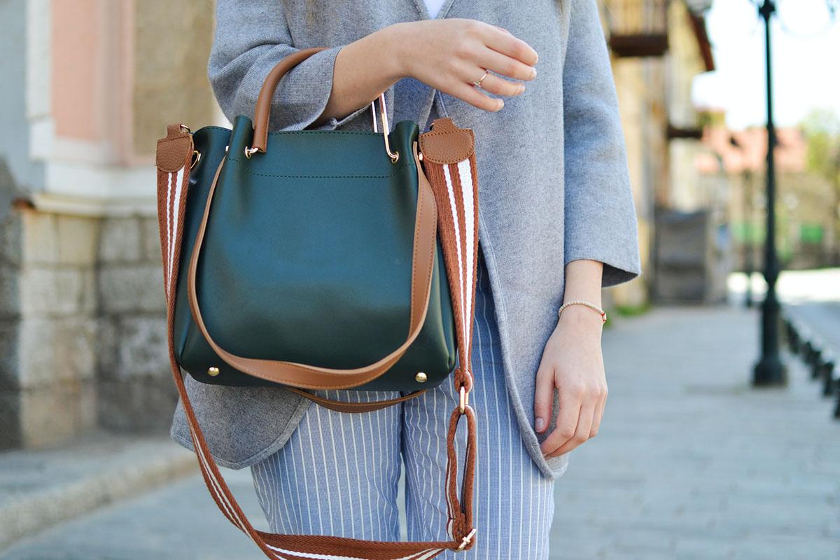A girl with a stylish crossbody bag