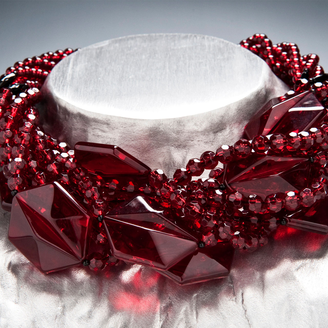 Angela Caputi red glass necklace on display at her shop in Florence