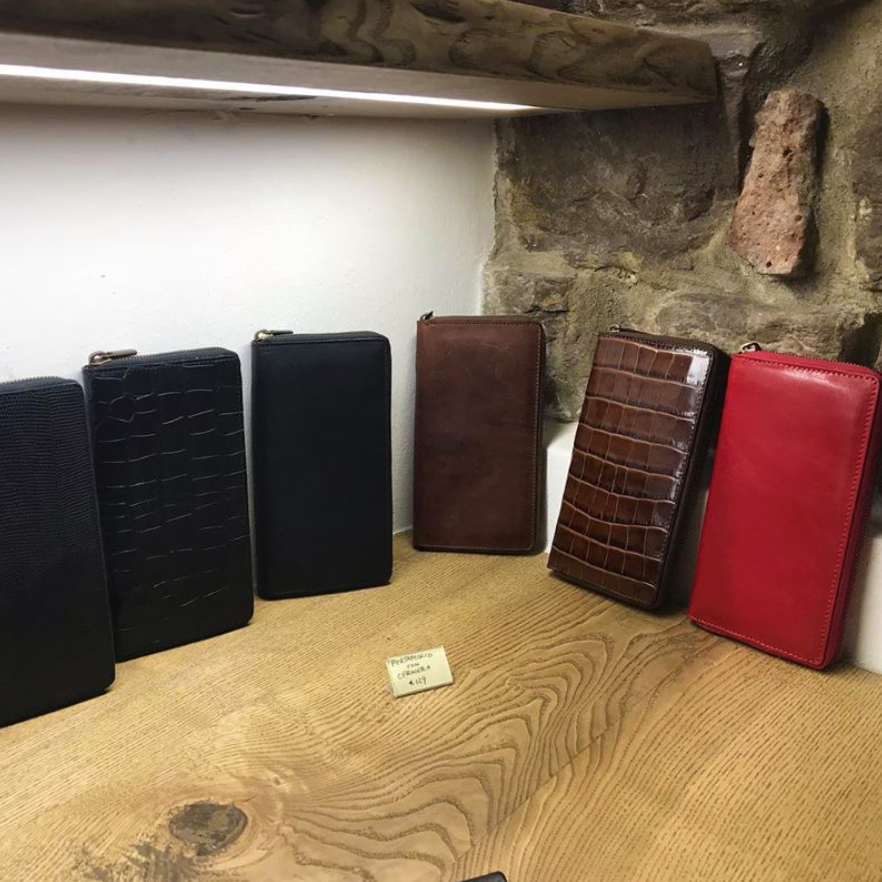 Handmade leather wallets in a shop in Florence