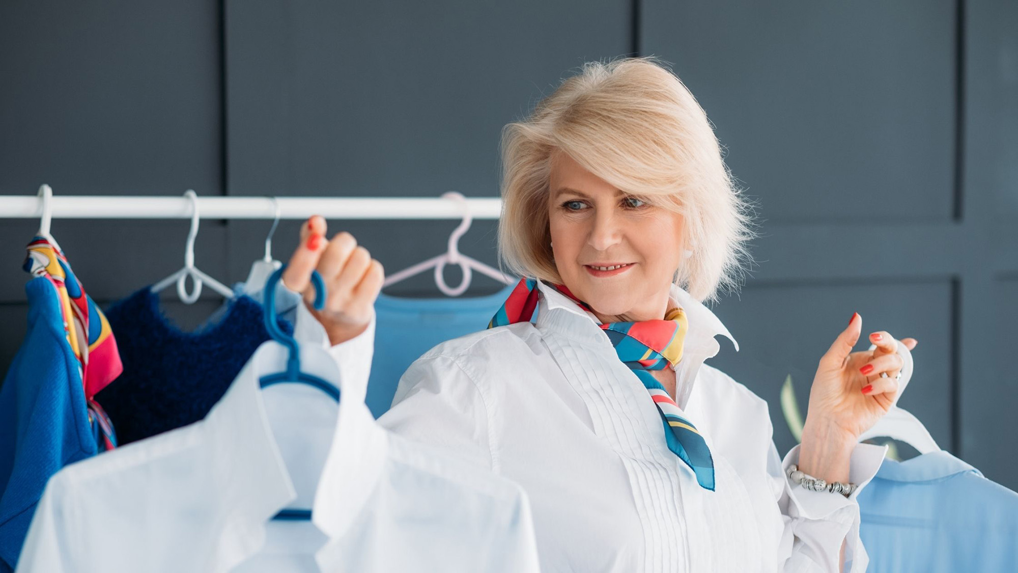 An image consultant works with her client and finds fashion outfits for her