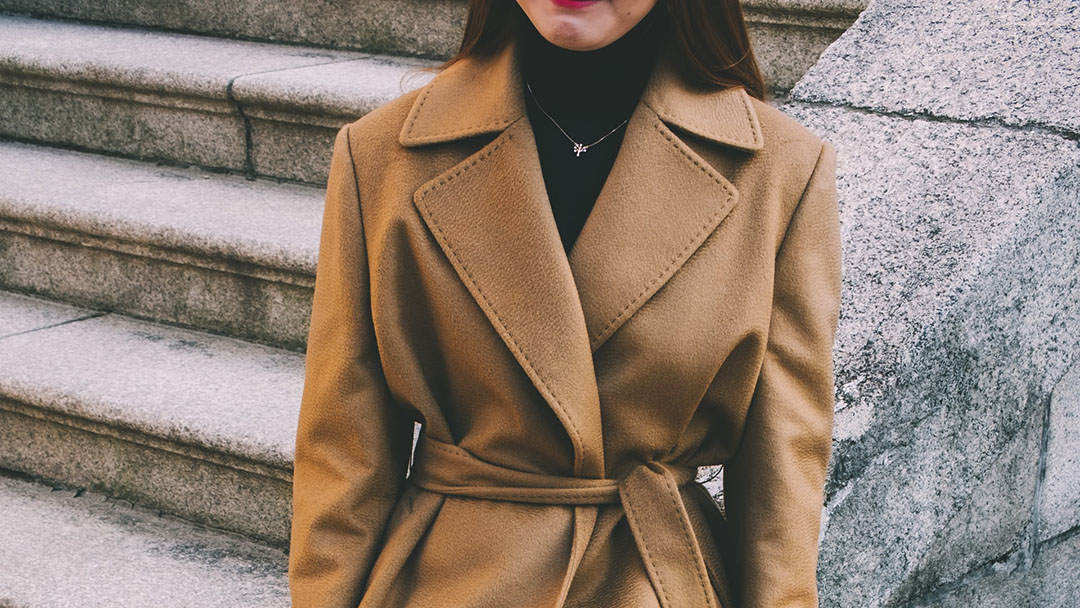 Woman wearing a nice camel coat