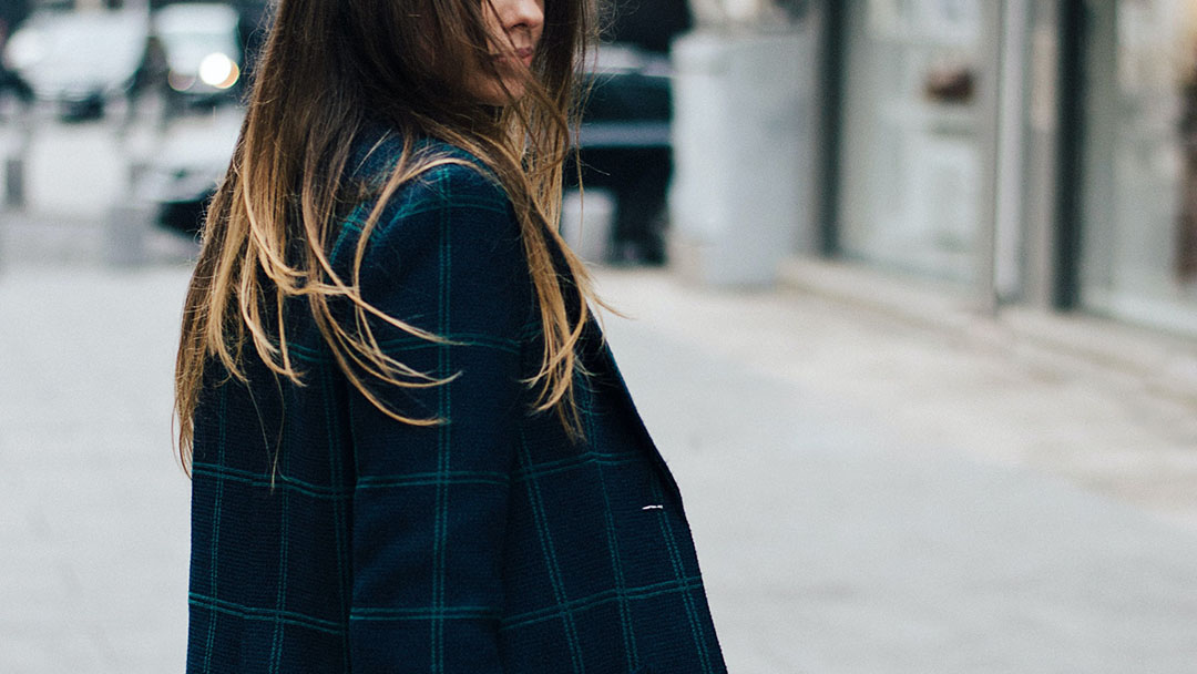 A woman with a checkered coat