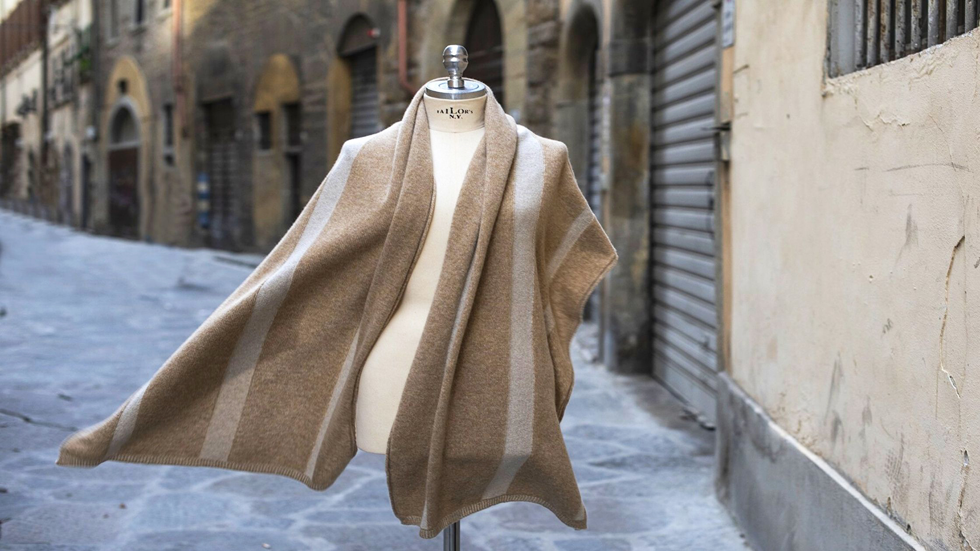 My Pieracci's beige sweater showcased on the street in Florence