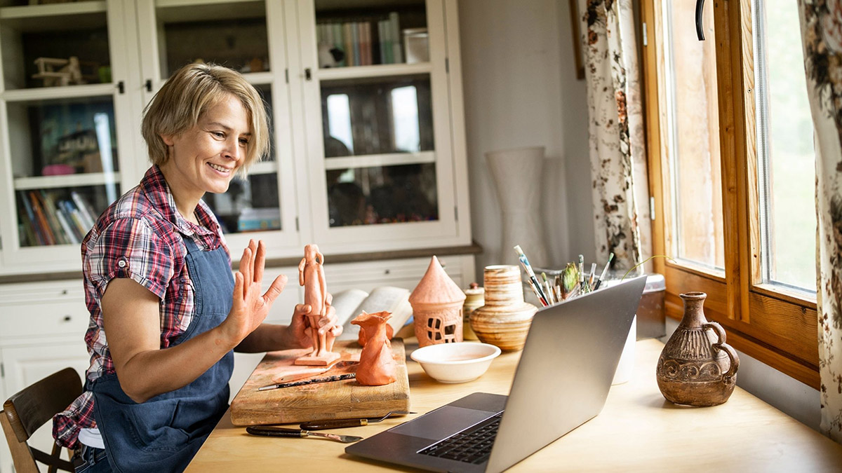 A pottery artisan teaches a class online in Florence