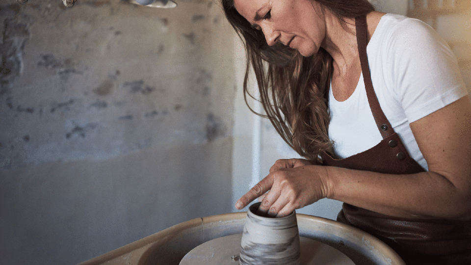 Artisan woman crafts a vase in Florence