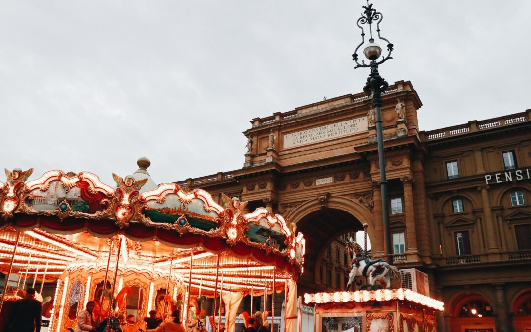 People have fun at the carousel in Florence