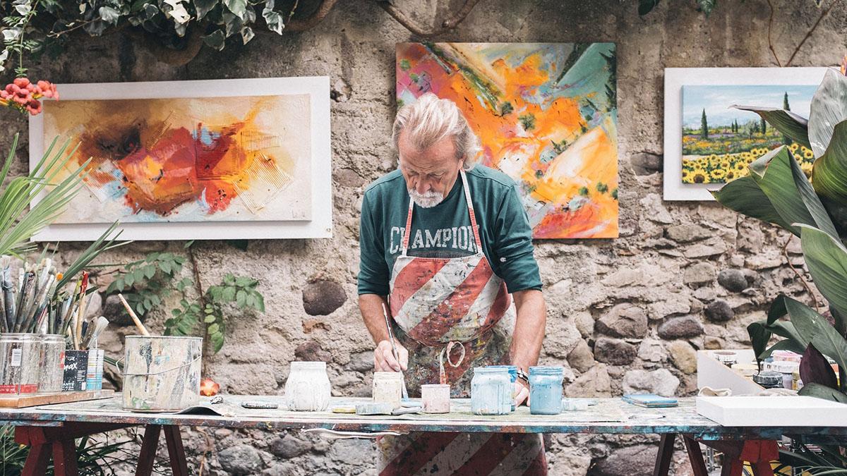 An artisan makes ceramic plates in Florence