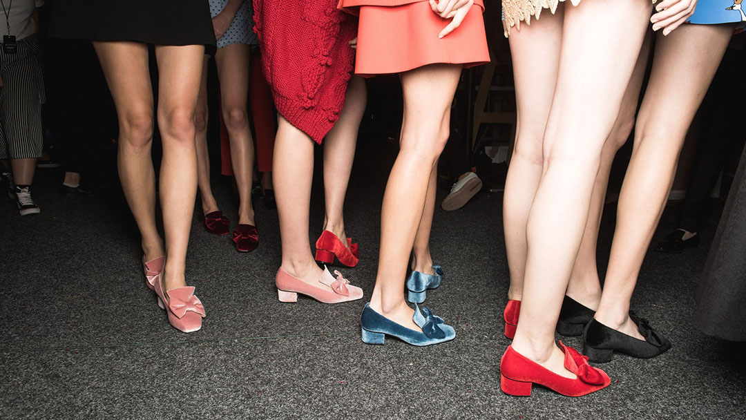 Models wearing colorful luxury shoes