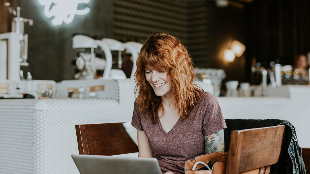 A woman having fun and learning about style online
