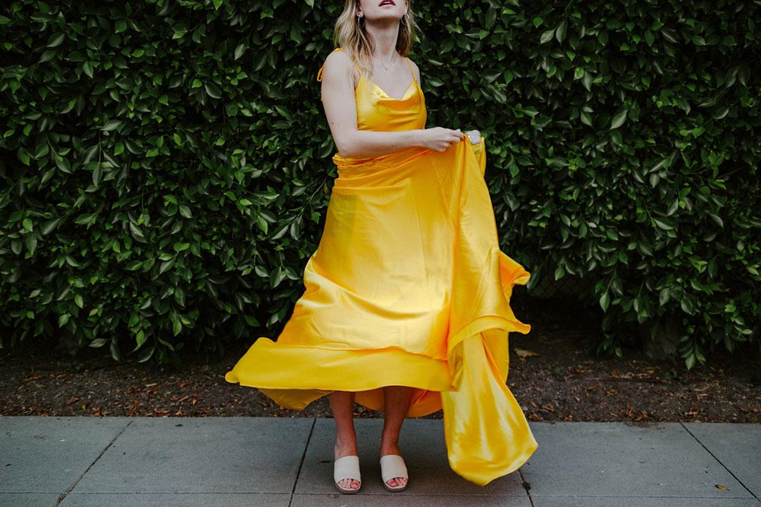 A Florentine girl wears a trendy yellow dress